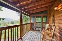 Wooden rocking chairs on the deck to enjoy your morning coffee