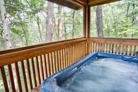Private hot tub on the screened in deck