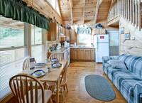 Living room and kitchen of Sugar Shack - 1 bedroom cabin in Gatlinburg, TN
