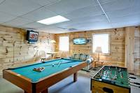 Pool table, TV and foosball table