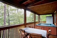 Hot tub on the outside deck ofBarefoot Dreams 2 bedroom cabin in Pigeon Forge
