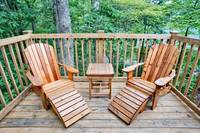 2 adirondack chairs and table on the porch