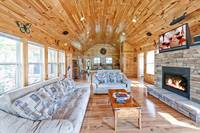 Above the Clouds - 2 bedroom affordable Gatlinburg Cabin - Heartland Cabin Rentals - Living Area with gas fireplace