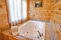 Above the Clouds - 2 bedroom Gatlinburg Cabin - Heartland Cabin Rentals - Jacuzzi tub Master Bedroom