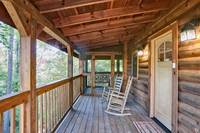 Deck with rocking chairs at Afternoon Delight - 1 bedroom cabin near Pigeon Forge