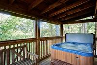 Hot tub and porch swing at Afternoon Delight - 1 bedroom cabin near Pigeon Forge