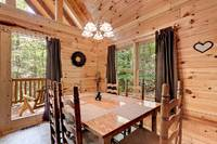 Across the Smokies - dining table of this 3 bedroom Gatlinburg cabin rental