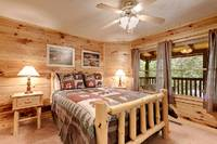 Across the Smokies - bedroom of this 3 bedroom Gatlinburg cabin rental