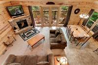 Across the Smokies - the living room with fireplace of this 3 bedroom Gatlinburg cabin rental