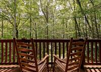 Across the Smokies - rocking chairs of this 3 bedroom Gatlinburg cabin rental