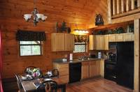 Full kitchen in this 2 bedroom cabin between Gatlinburg and Pigeon Forge