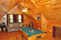 Pool table in the loft with TV and sleeper sofa