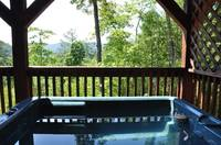 Hot tub with mountain views at Mountain Breeze