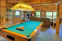 Pool table near the living room area of Cozy Mountain Hideaway