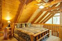 Upstairs sleeping area with ceiling fan