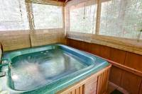 Hot tub on the screened in deck area
