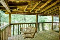 Wooden porch swing on the deck