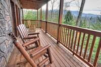 Lower Deck with wooden rocking chairs - 3 bedroom cabin in Gatlinburg, TN