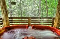 hot tub of this 1 bedroom cabin in between Gatlinburg and Pigeon Forge