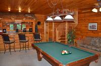Sleeper sofa, pool table and wet bar