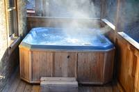 Hot Tub lower deck Cabin near Dollywood in Pigeon Forge, TN - by Heartland Cabin Rentals