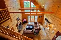 Loft looking down into Living Room of this 2 bedroom cabin near Gatlinburg