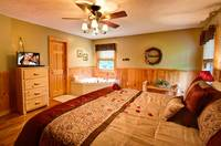 Master Bedroom with tub in this Gatlinburg cabin rental
