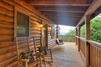 Front porch of this 2 bedroom cabin convenient to both Pigeon Forge and Gatlinburg