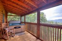 Hot tub on the deck with wooden rocking chair