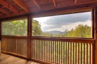 Screened deck with mountain view of this 2 bedroom cabin that sleeps 4