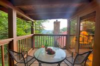 Private deck off of the master bedroom of this private cabin between Pigeon Forge and Gatlinburg