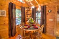 Table in the dining area of this 2 bedroom cabin in Pigeon Forge