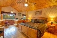 Master Bedroom of this 2 bedroom Pigeon Forge Cabin that sleeps 6
