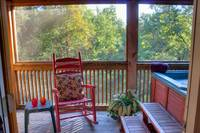 Rocking Chair beside the Hot Tub of this Pigeon Forge cabin rental