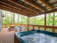 Outdoor hot tub, table and chairs with picnic table