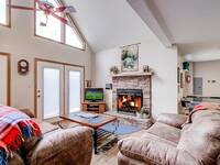 Living room  with fireplace and TV of a 3 bedroom chalet in Wears Valley and a short drive to Pigeon Forge