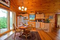 Full kitchen with dining room table and chairs