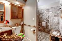 Full bathroom with large shower that is wheelchair friendly - handicap accessible