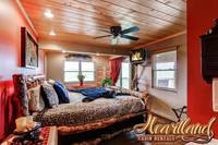 Bedroom with  king bed, TV and sliding glass doors to the deck