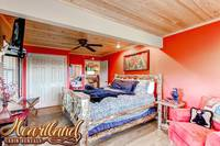 King bed with ceiling fan and TV
