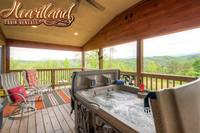 Hot tub and chairs with amazing views of the mountains