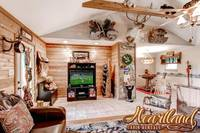 Living area with large TV in this 1 bedroom Pet Friendly Cabin