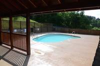 Covered area at Swimming Pool - accessible when renting this 5 bedroom cabin in Pigeon Forge