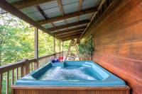 Hot Tub on Deck of Cabin in Pigeon Forge - 2 bedroom cabin rental