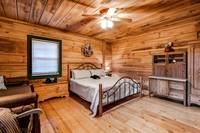 King bed in the Master Bedroom of this Wears Valley Cabin Rental