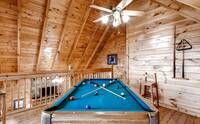 Pool table with ceiling fan