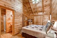 Master bedroom with king bed, TV and bathroom