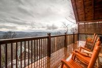 Wooden porch chairs to sit and enjoy the mountain views