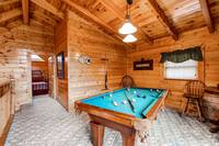 Cabin has a Pool Table in loft area