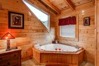 Master Bedroom has large tub